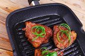 grilled beef fillet strips on grill teflon black plate over wood