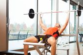 picture of yoke  - Man lifting a yoke in a fitness club - JPG