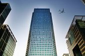LONDON, UK - JUNE 30, 2014   Aircraft over the London s skyscrapers going to land in the City airpor