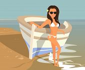 Brunette woman wearing white swimsuit is posing near boat on the beach