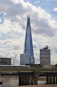 LONDON, UK - JUNE 30, 2014  Shard of glass on the river Thames, office and residential building in t