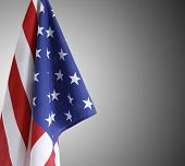 Closeup of American flag in front of grey background