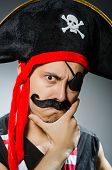 Funny pirate in the dark studio
