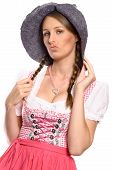 Proud Woman, Wearing A Rustic Hat And A Dirndl