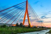 Cable stayed bridge in Gdansk at sunset, Poland
