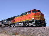 Orange locomotive freight train