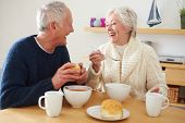 Senior Couple Having Bowl Of Soup For Lunch