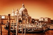 Venice, Italy. Gondolas on Grand Canal and Basilica Santa Maria della Salute. Vintage style, golden