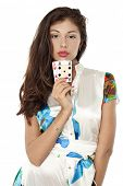 Beautiful brunette holding two aces, isolated on white