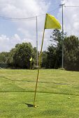Yellow Golf Flag On The Beautiful Golf Course