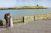 Man Looking To Dalkey Island By Binoculars