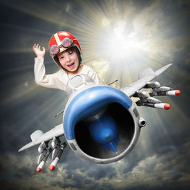 image of fighter plane  - Happy little pilot flying in retro jet fighter - JPG