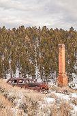 Rusty Auto And Brick Chimney