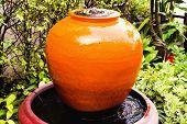 Fountain jar in home garden