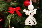 stock photo of christmas angel  - Knitted Christmas angels on Christmas tree - JPG