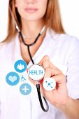 Female doctor with stethoscope and virtual screen