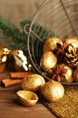 Beautiful Christmas composition with golden walnuts, on wooden table
