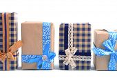 Gift boxes on light blue uneven background