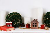 Christmas decoration on shelf on white background