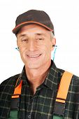 Experienced gardener wearing ear protectors
