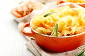 pic of shrimp  - Pasta baked with shrimps and cheese in ceramic pot - JPG