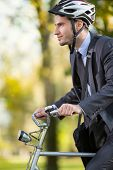 young businessman in suit wearing bike helmet go to work
