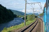 Train Going Near The River In The Carpathians