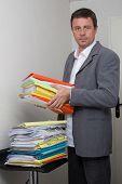 a business man using a copy machine