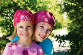 Two Little Girls Outdoors With Kerchiefs On Their Heads