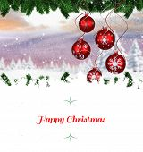 Christmas greeting card against christmas scene with baubles