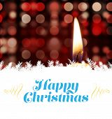 Christmas greeting card against candle burning against festive background