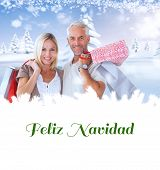 happy couple with shopping bags against feliz navidad