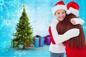 Mother and daughter with gift against christmas tree with gifts