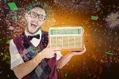 Geeky hipster holding a retro radio against colourful fireworks exploding on black background