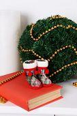 Christmas decoration on mantelshelf on white background