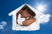 Intimate couple messing about in the morning on bed against bright blue sky with clouds