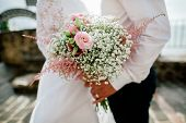 Wedding Bouquet In Groom's And Bride's Hands Closeup
