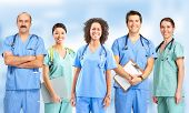 stock photo of nurse practitioner  - Smiling medical people with stethoscopes - JPG