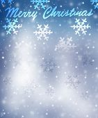 Merry Christmas greeting card, beautiful blue snowflakes border on blurry background with text space, postcard with best wishes for winter holidays