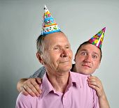 stock photo of ugly  - Funny Men Faces Senior man and son making an ugly and funny grimace - JPG