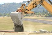 pic of track-hoe  - A large tracked hoe or excavator working at a construction site - JPG