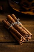 Cinnamon on the wooden background.