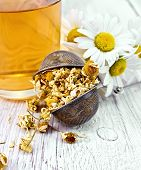 foto of chamomile  - Dried chamomile in strainer - JPG