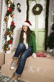 happy young real american girl at home decorated on Christmas
