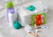foto of nipple  - Items for newborn diapers ear sticks toy squirt cream and powder nipple pacifier - JPG