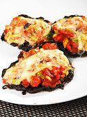 picture of portobello mushroom  - Stuffed portobello mushrooms with tomatoes and yellow cheese  - JPG