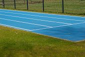 stock photo of race track  - Blue Tartan race track with guide lines - JPG