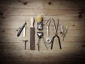 picture of barber  - Set of vintage barber tools on wood desk - JPG