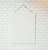 foto of canvas  - Blank canvas hanging on the wall decorated with white tiles - JPG