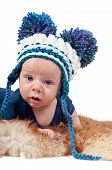 stock photo of pom poms  - Closeup portrait of adorable baby boy in hat with pom - JPG